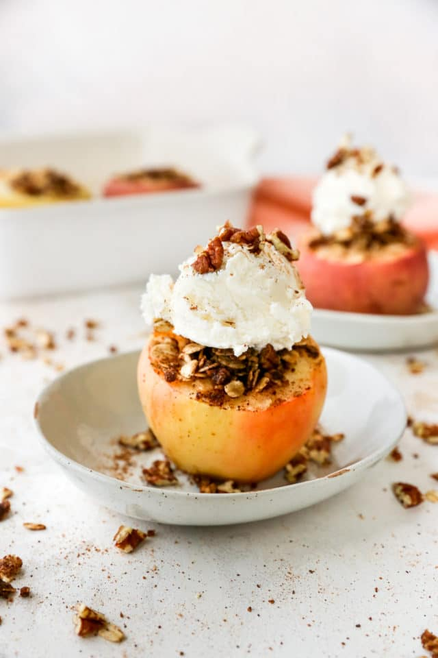 baked apples with crisp topping and served with vanilla ice cream