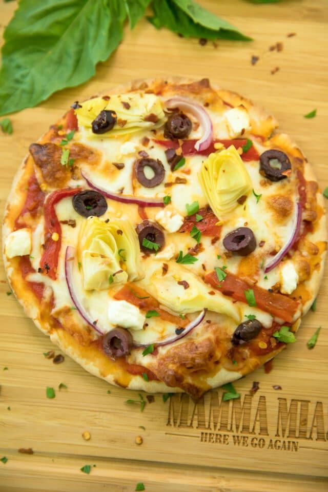 closeup overhead photo of Easy Greek Pita Pizzas Recipe