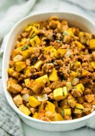overhead photo of Delicata Squash Stuffing in a white casserole dish