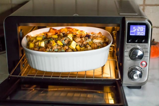 Delicata Squash Stuffing in a white dish coming out of a toaster oven