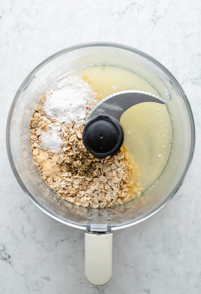 combining egg whites, oats and baking powder in a food processor