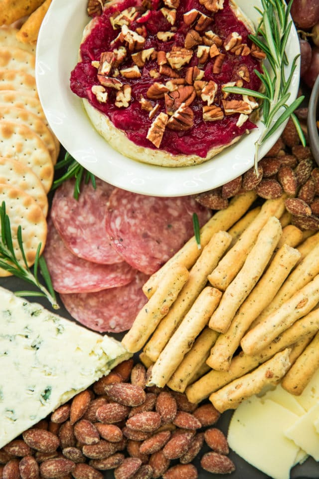 snack tray with meats, cheeses and dips