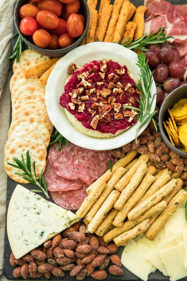 holiday cheese board with cranberry sauce baked brie