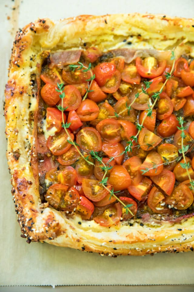 tomato tart on a baking sheet just out of the oven