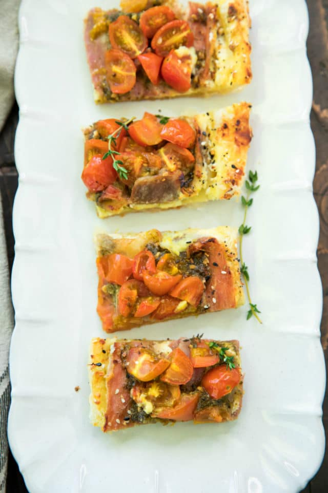 slices of tomato tart served on a white serving tray