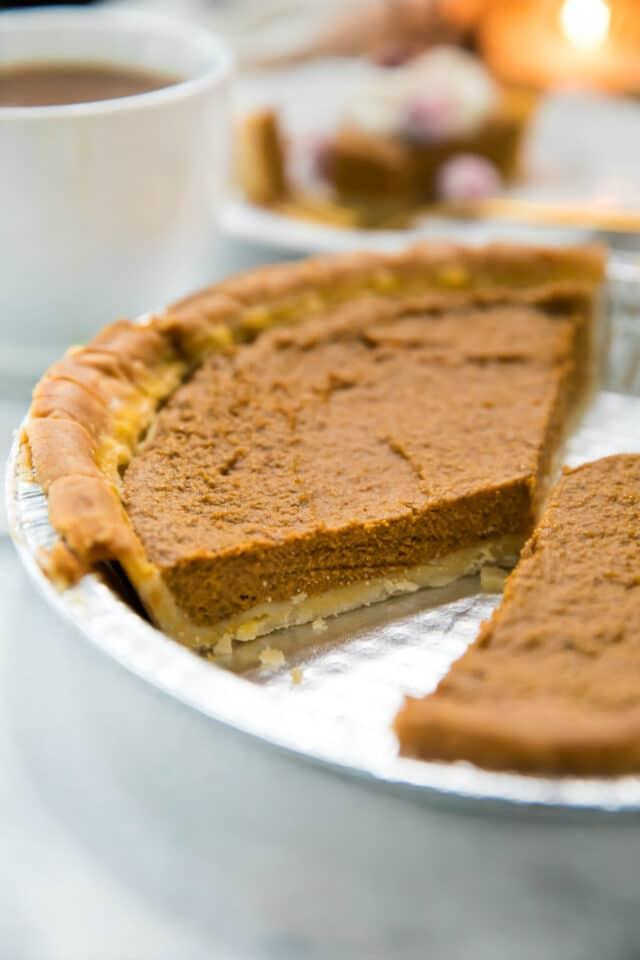 sliced pumpkin pie in a baking dish