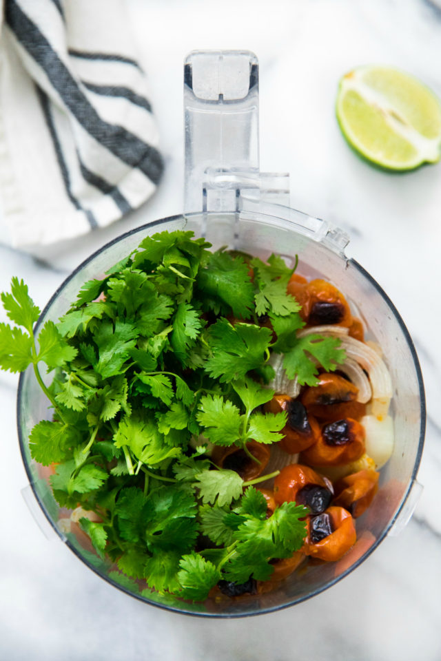 cilantro and other veggies in a food processor for salsa