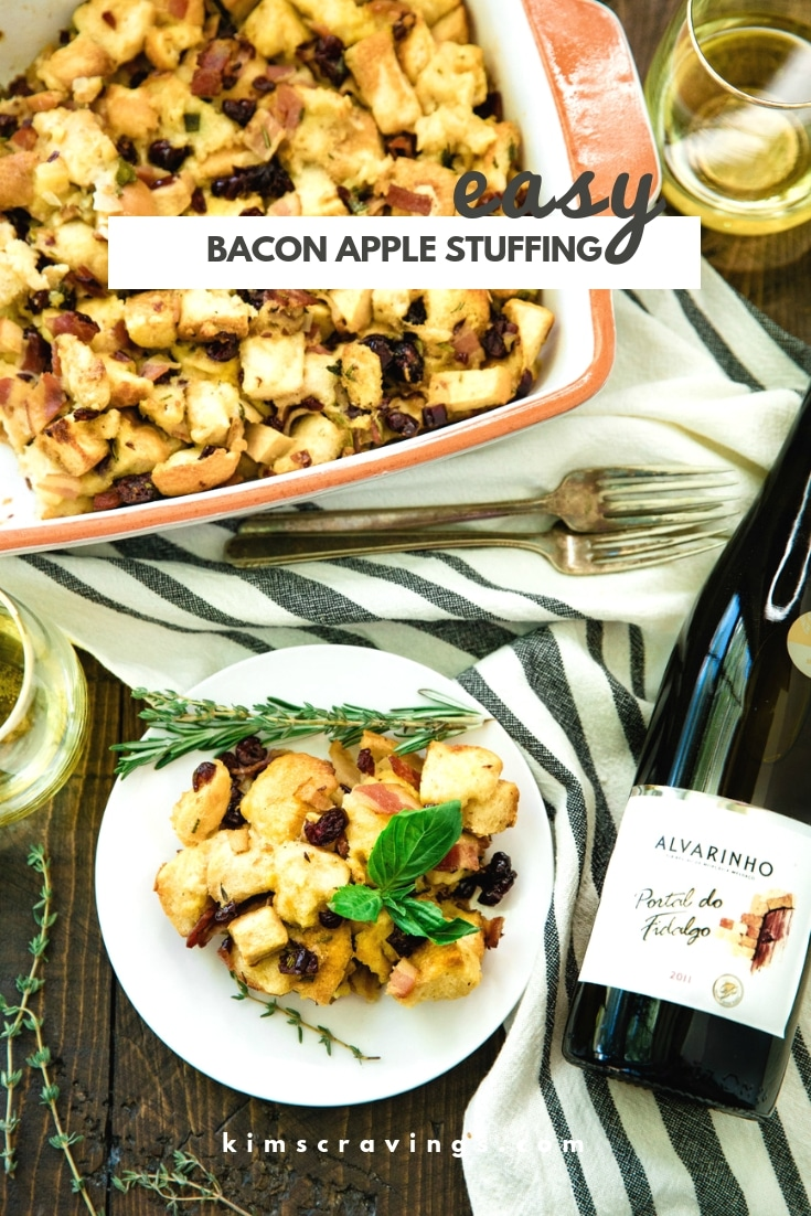 stuffing served on a white plate with a bottle of wine