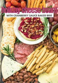 cheese board filled with meats, crackers, cheeses and cranberry sauce brie