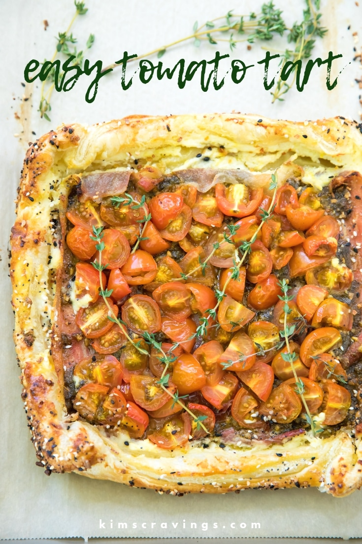 Brightly colored tomatoes, flavorful pesto, creamy ricotta and salty prosciutto layered on a buttery puff pastry makes this Easy Tomato Tart Recipe an impressive appetizer and perfect for holiday noshing! #holidayappetizer #tomatotart #holidayparty