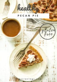 piece of pecan pie on a small plate served with a cup of coffee