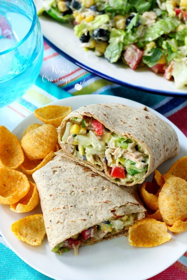 tuna salad wrap served on a white plate with chips
