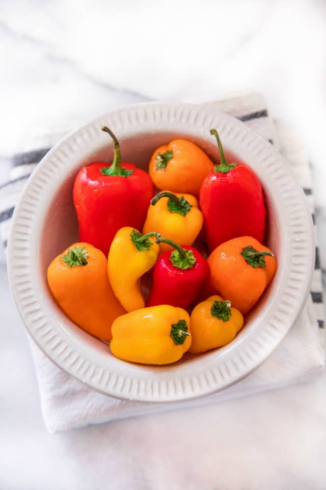 colorful mini peppers in a white bowl