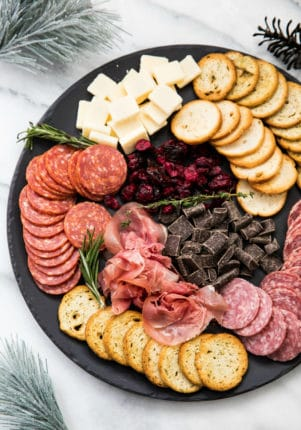 easy party platter with prosciutto, Salame, cheese, crackers and chocolate