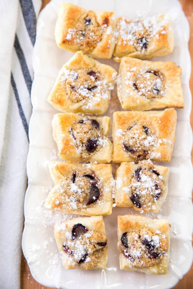 puff pastry bites on a white serving tray