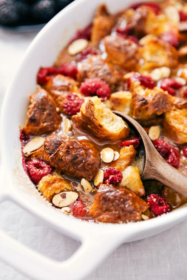 bread pudding topped with raspberries and sliced almonds