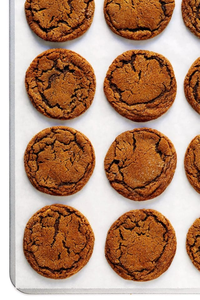 molasses cookies evenly placed on a baking sheet