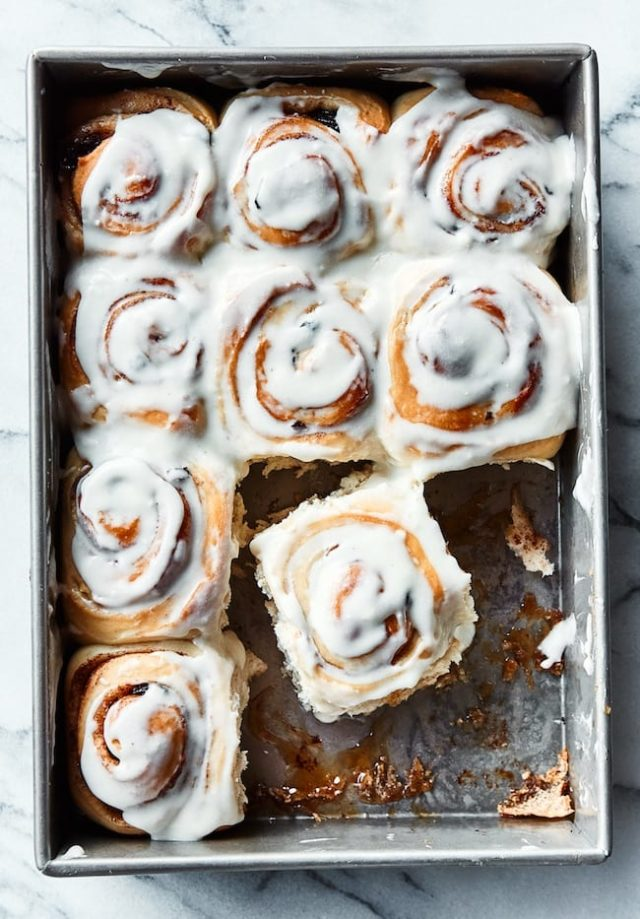 cinnamon rolls cut apart in a pan