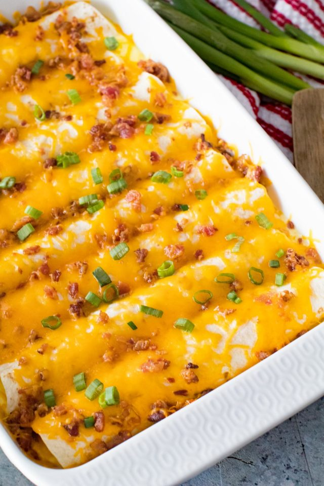 overnight breakfast enchiladas covered in cheese
