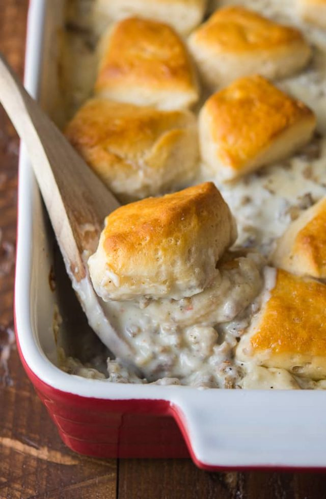 sausage gravy mix with biscuits on top being spooned out