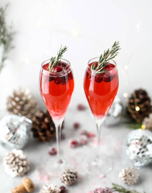 cranberry mimosas served in champagne flutes