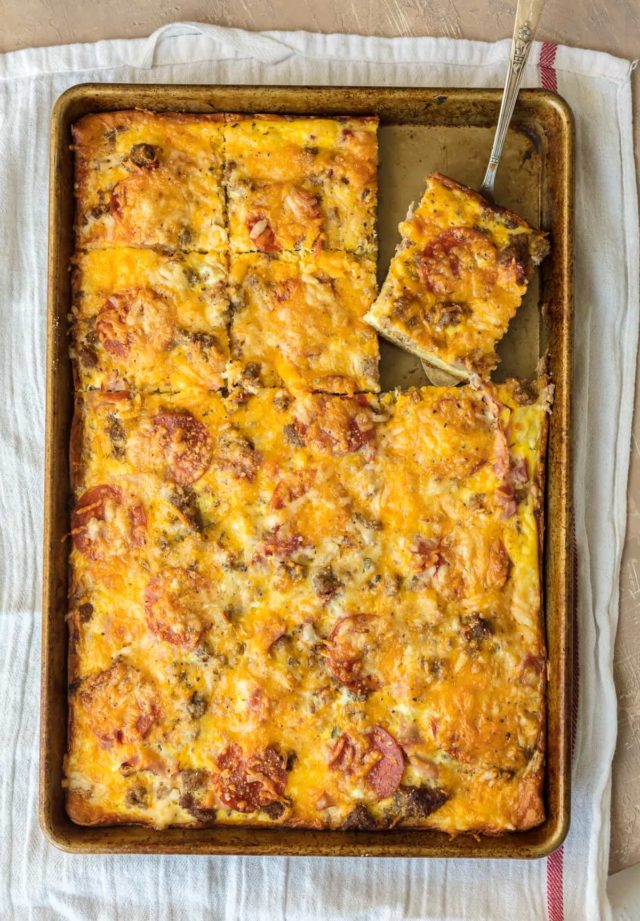 breakfast pizza served on a cookie sheet pan