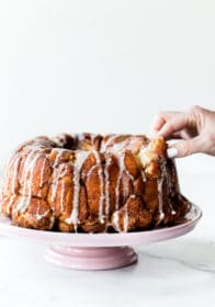 homemade monkey bread on a pink cake stand
