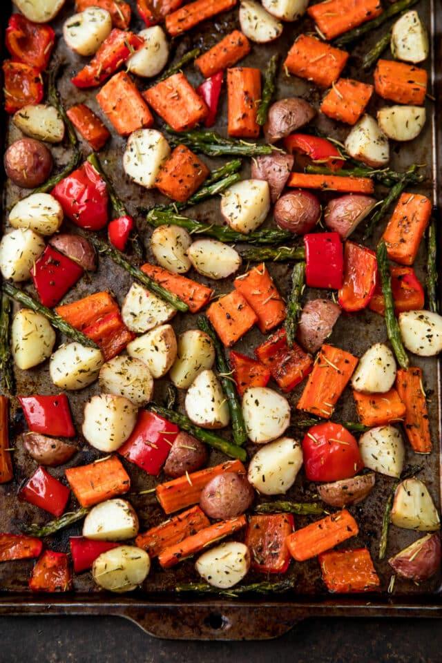 Roasted veggies on a baking sheet pan.