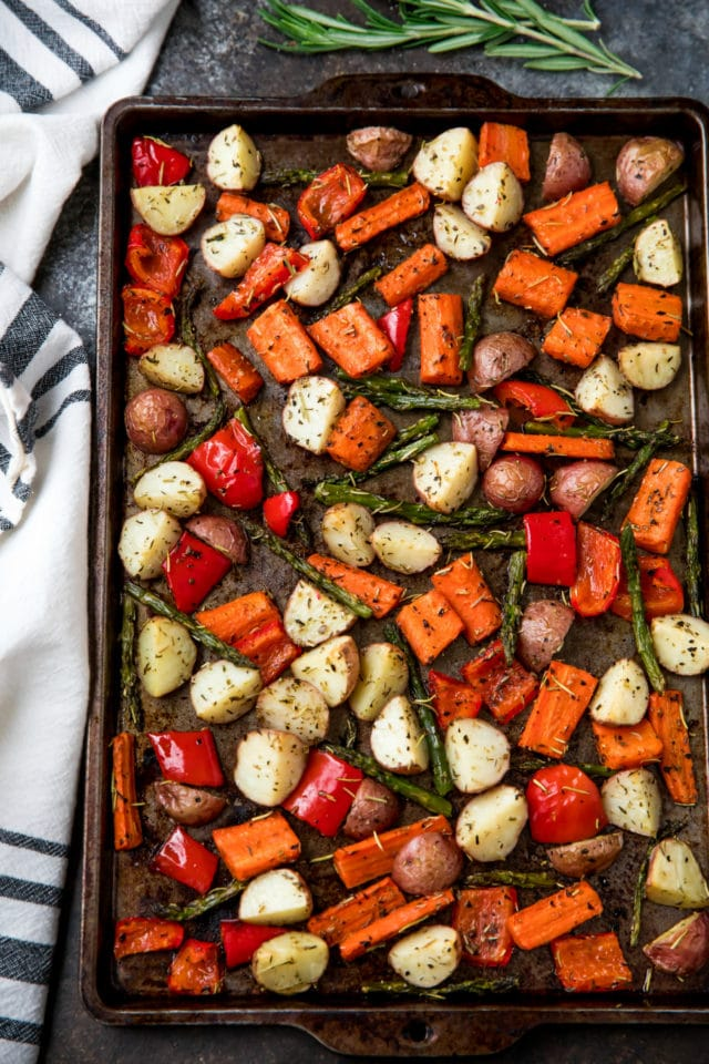 sheet pan with roasted red pepper, red potatoes, asparagus and carrots