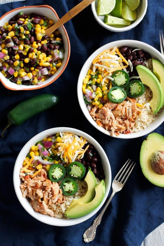 burrito bowls with ingredients to the side