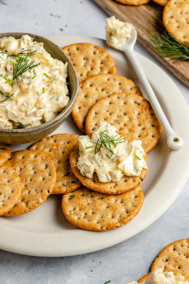 healthy egg salad served on crackers with fresh dill