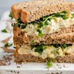 healthy egg salad sandwich served on wheat bread