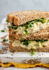 healthy egg salad sandwich served on wheat bread