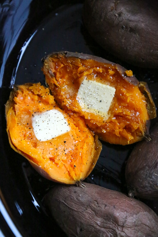 sweet potato cut in half and topped with butter
