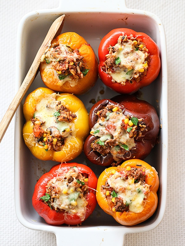 colorful stuffed bell peppers in a casserole dish