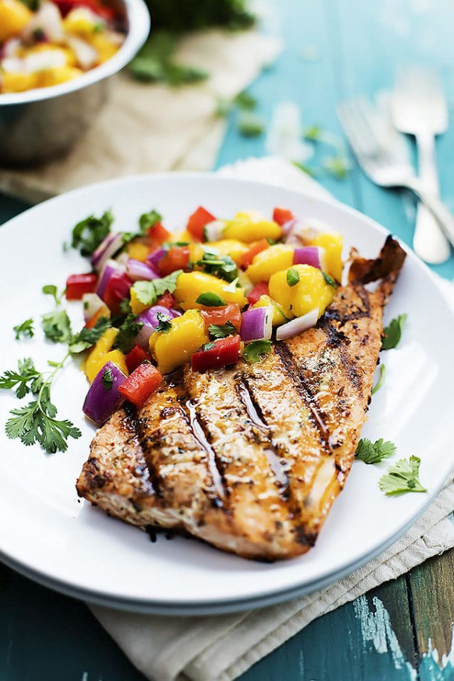 grilled salmon with mango salsa on a white plate