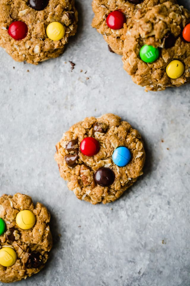 oatmeal monster cookies on a baking sheet topped with colorful candies