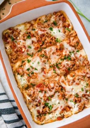casserole dish with lasagna cut into squares