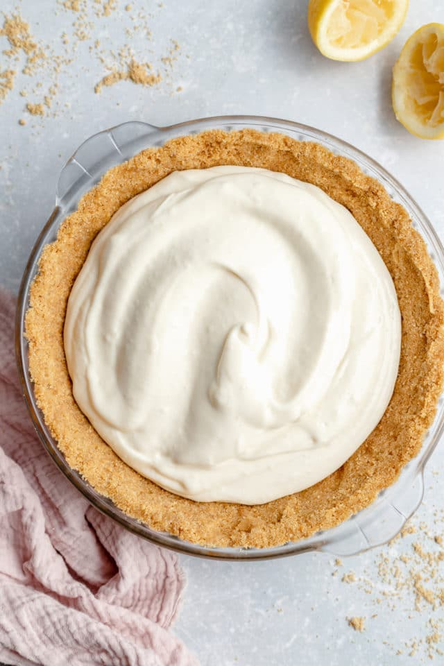 cream cheese pie filling poured into a graham cracker crust