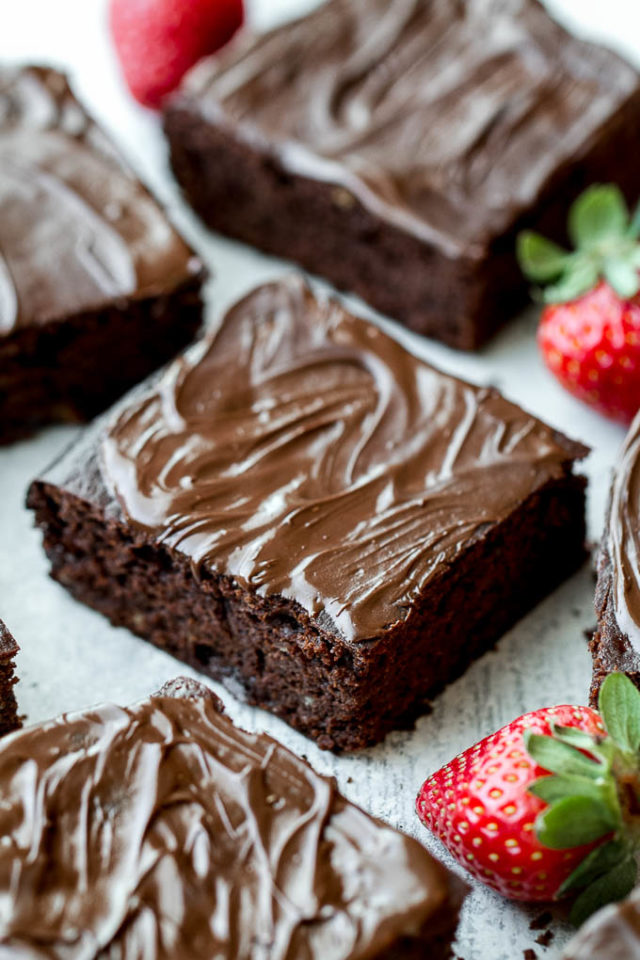 Brownies with icing and strawberries
