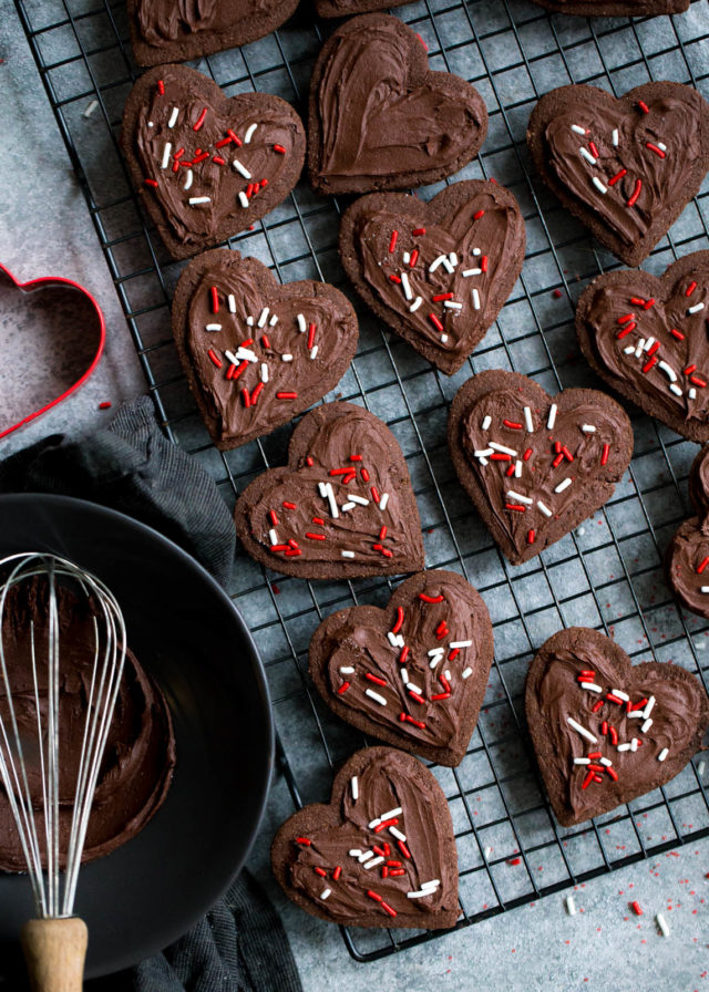 Chocolate heart-shaped sugar cookies with white and red sprinkles