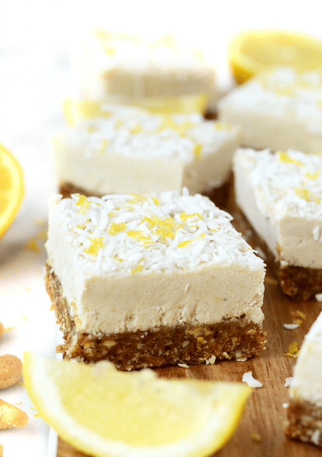 cheesecake bars cut into squares and topped with lemon zest