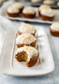 a carrot cake muffin with a bite out