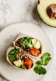vegan burrito facing up on a plate