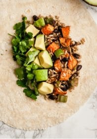 tortilla filled with brown rice, sweet potato and black beans