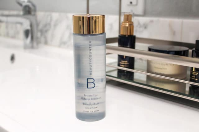 Beautycounter eye make-up remover sitting on a white bathroom counter