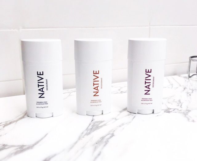 Native deodorant in three varieties on a marble bathroom counter
