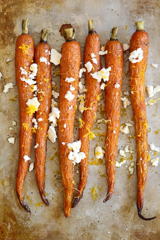 Roasted Heirloom Carrots with Feta and Lemon Zest on a baking sheet