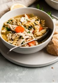 homemade chicken noodle soup served with crusty bread