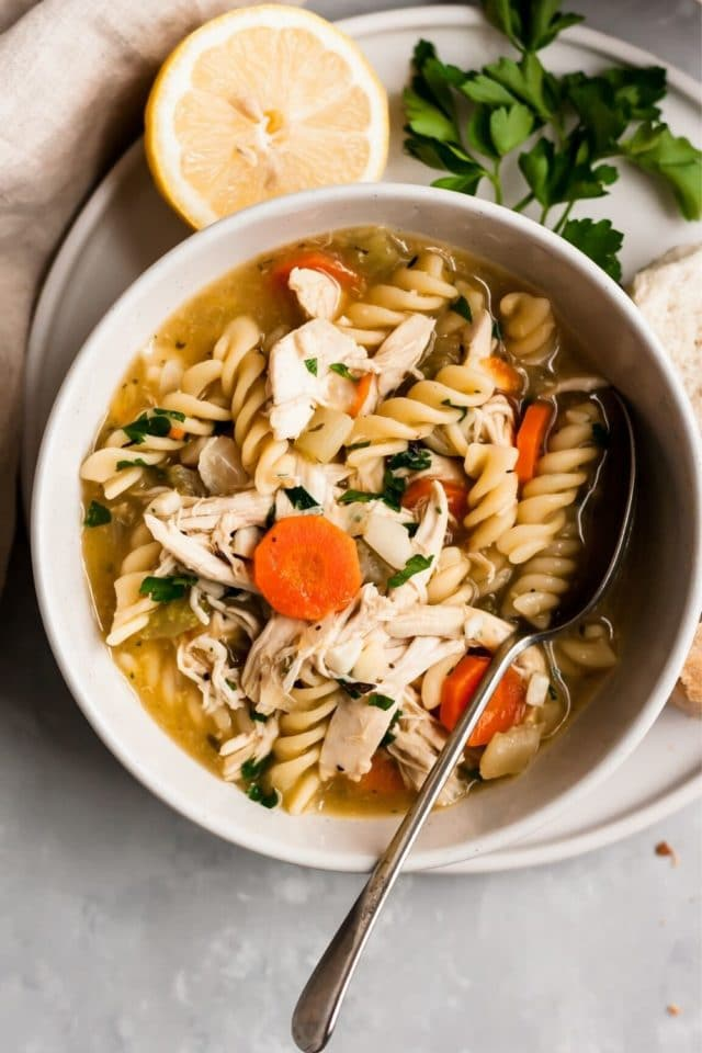 bowl of chicken noodle soup with a spoon